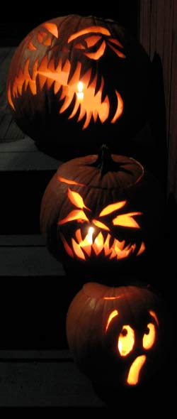 three pumpkins, two scary, one scared
